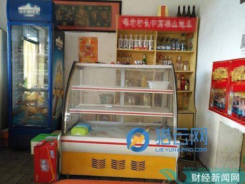 广通汽车旁的小饭馆用来卖凉菜的橱柜由于顾客太少已经闲置